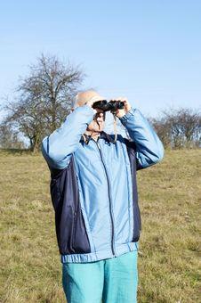 Senior Man With Binoculars Royalty Free Stock Image