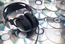 Free CDs Background And Headphones Royalty Free Stock Image - 16989126