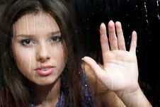 Free Girl Behind Wet Window Royalty Free Stock Image - 16991216