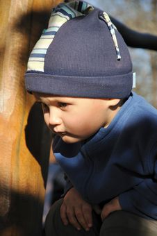 Free Squatting Boy Stock Photo - 16993870