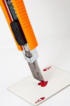 Free Utility Knife Pointing At A Playing Card Royalty Free Stock Photo - 16994915