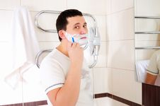 Free Young Man Shaving In His Bathroom Stock Photo - 16995380