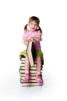 Free Cute Little Girlsit Near A Big Books Royalty Free Stock Images - 16995449