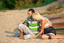 Free Boy And Girl Laughing On The Beach Royalty Free Stock Image - 16996626