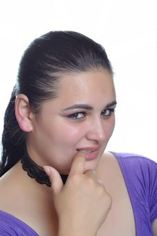 Free Woman Is Shy With Finger In Mouth Royalty Free Stock Photos - 16999408