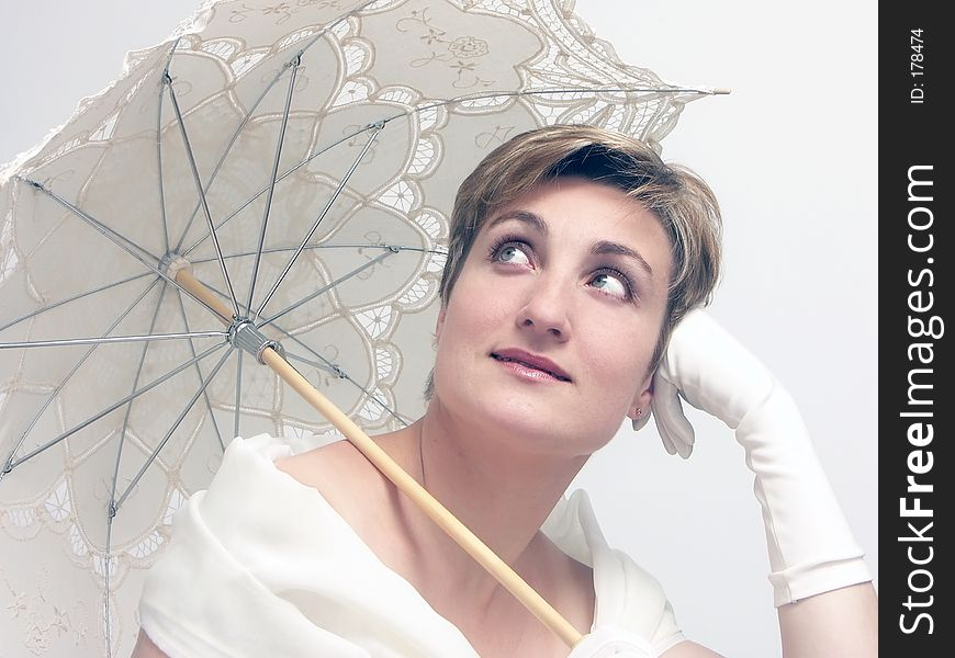 Beautiful dreamy woman with fancy umbrella