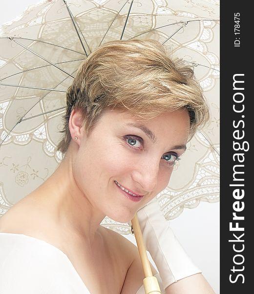 Beautifu dreamy woman holding fancy umbrella