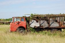 Free Old Red Truck In Field Collecting Rust Stock Images - 1701414