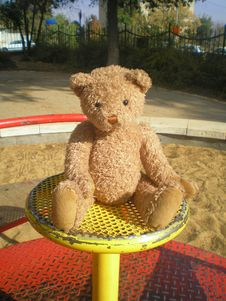Teddy Bear On The Merry-go-round Stock Images