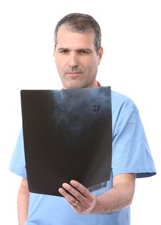 Doctor Looking At A Xray Royalty Free Stock Images