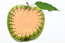 Free Apple With A Patch Sewn By Black Threads Stock Photography - 17002472