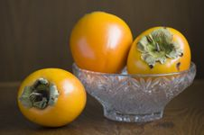 Three Persimmons Still Life Royalty Free Stock Images