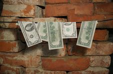 Dollars Hang On A Rope Royalty Free Stock Photo
