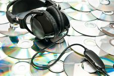 Free Headphones On Cds Stock Image - 17007811