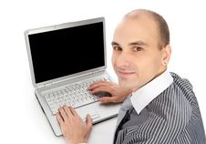 Free Young Businessman Using Laptop Stock Image - 17007891