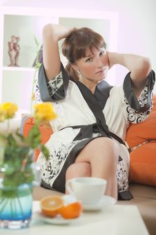 Free Woman In Bathrobe On Sofa Stock Images - 17008194