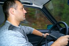 The Man Sits At The Wheel The Car Royalty Free Stock Images