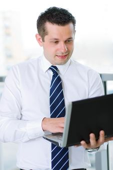 Free Businessman Working On Laptop Stock Photography - 17009342