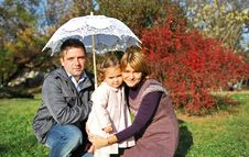 Happy Parents And Little Girl Stock Images