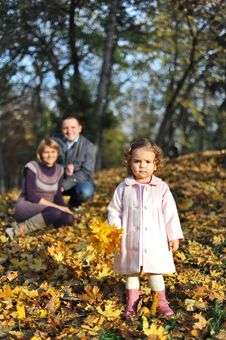 Happy Parents And Little Girl Stock Photo
