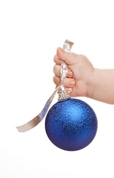 Free Baby Hand With Blue Christmas Bauble Stock Photos - 17010603