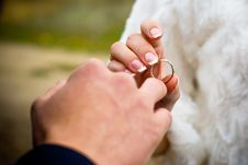 Putting On A Wedding Ring Royalty Free Stock Photography