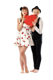 Two Girls With Red Cardboard Heart Stock Images