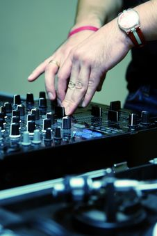 Free DJ Adjusting Sound Level On Mixer Stock Photo - 17018670
