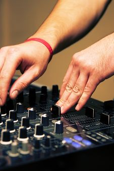 Free DJ Adjusting Sound Level On Mixer Royalty Free Stock Images - 17018699