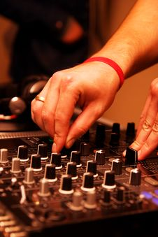 Free DJ Adjusting Music Level On Mixer Royalty Free Stock Image - 17018726
