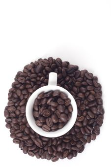 Cup Of Dark Roasted Coffee Beans Stock Photos