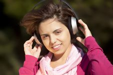 Free Pretty Young Girl Listening Music Stock Image - 17020671