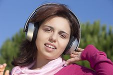 Free Pretty Young Girl Listening Music Royalty Free Stock Photo - 17020695
