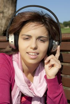 Free Pretty Young Girl Listening Music Royalty Free Stock Photos - 17020738