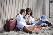 Free Young Couple Enjoying  Picnic On The Beach Royalty Free Stock Photo - 17021325