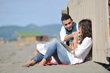 Free Young Couple Enjoying  Picnic On The Beach Stock Photos - 17021353