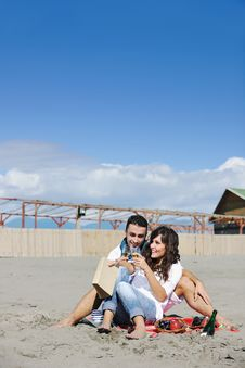 Free Young Couple Enjoying  Picnic On The Beach Stock Photography - 17022222