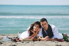Free Young Couple Enjoying  Picnic On The Beach Stock Image - 17022321