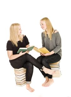 Girls Sitting On Pile Of Books Royalty Free Stock Image