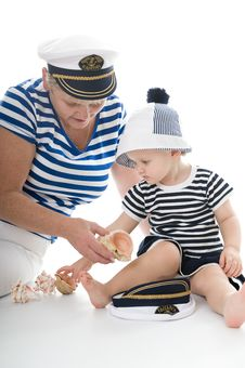 Captain Woman In Studio With Baby Royalty Free Stock Images