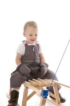 Free Baby In Studio Is Playing On Sledge Stock Photos - 17027923