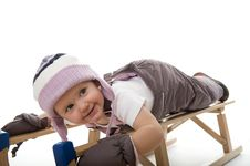 Free Baby In Studio Is Playing On Sledge Royalty Free Stock Image - 17027966