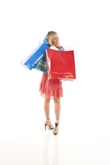 Free Young Woman With Shopping Bags Royalty Free Stock Photography - 17028127