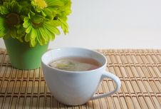 Free Cup Of Tea On Bamboo With Green Flowers Royalty Free Stock Photography - 17028167