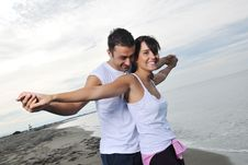 Free Happy Young Couple Have Fun At Beautiful Beach Stock Photos - 17028533
