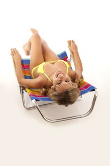 Free Young Woman Relaxing In Beach Chair Stock Photography - 17028622