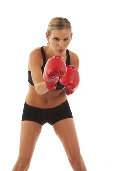 Young Woman With Red Boxing Gloves Royalty Free Stock Photo