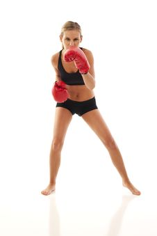 Young Woman With Red Boxing Gloves Royalty Free Stock Image
