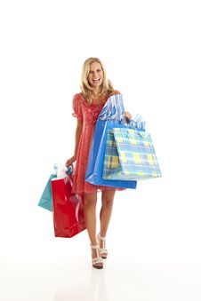 Free Young Woman With Shopping Bags Royalty Free Stock Photo - 17029325