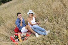 Free Happy Couple Enjoying Countryside Picnic Royalty Free Stock Photo - 17030535